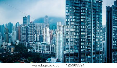 apartments in hongkong,blue toned image.