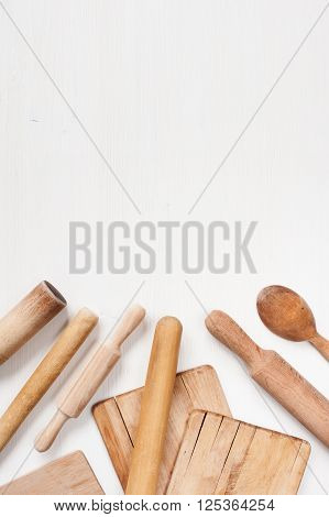 Kitchen utensils on the white wooden table
