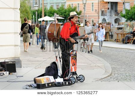 LJUBLJANA SLOVENIA - JULY 9 2009: Street musician one-man-band Jimmy Jimmy performing multiple instruments