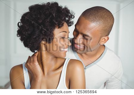 Smiling couple looking at each other at home