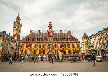 LILLE FRANCE - JUNE 15: People passing city hall in Central town square La Grand Place in Lille in afternoon on June 2015