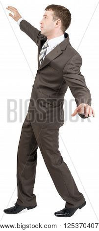Businessman standing on tiptoes isolated on white background