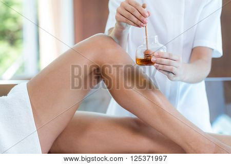 Woman receiving spa treatment with honey at spa