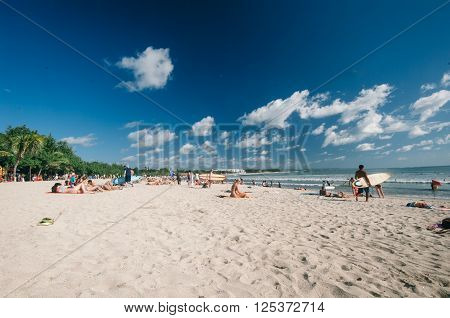 KUTA,INDONESIA - JULY 29 :tourist relax and enjoy surf in in the beach of Kuta on the 29th of july 2009 in Kuta Bali
