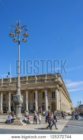Bordeaux France - March 26 2016. People walking in front of Grand Theatre de Bordeaux at sunny day. The theatre is home to the Opera National de Bordeaux and the Ballet National de Bordeaux. Bordeaux Aquitaine. France.