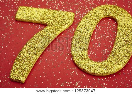 Number seventy golden color over a red background. Anniversary. Horizontal