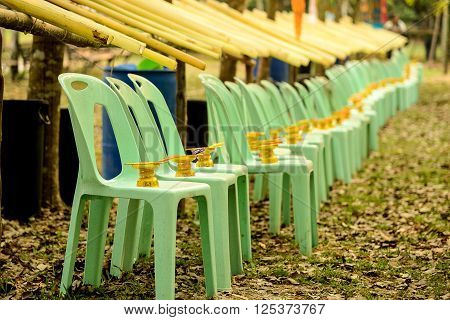 Tray gold on Green plastic chairs Gutter banana leaf.