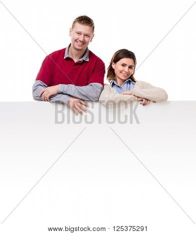 smiling couple lean on empty blanket for ad