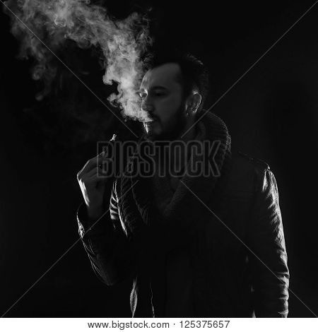 Bearded Stylish Man Holding And Smoking Electronic Cigarette