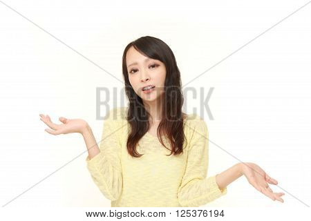 portrait of Japanese woman confused on white background