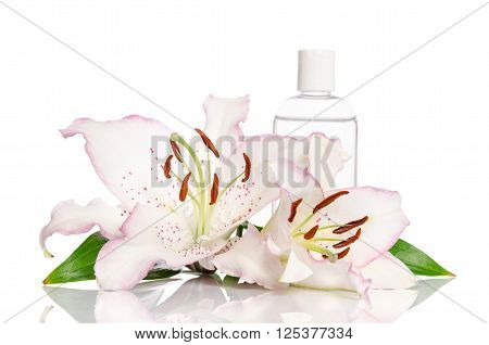 tonic for skin care with lily flower on a white background
