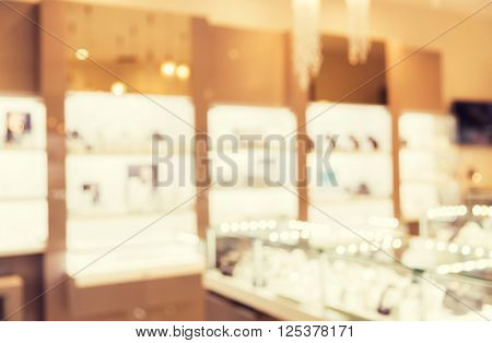 sale, consumerism, shopping and background concept - jewelry store blurred bokeh