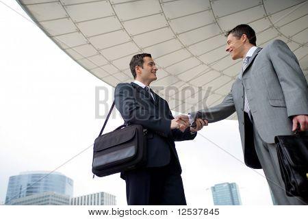 Portrait of two men shaking hands