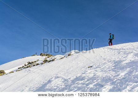 Tourist On A Snowy Ridge.