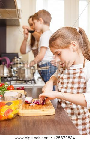 Teenage Girl Cooking Together With Her Family