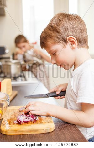Small Boy Cooking Together With His Sister