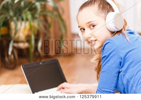 Teenage Smiling Girl Using Laptop On The Floor