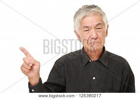 senior Japanese man doubting on white background