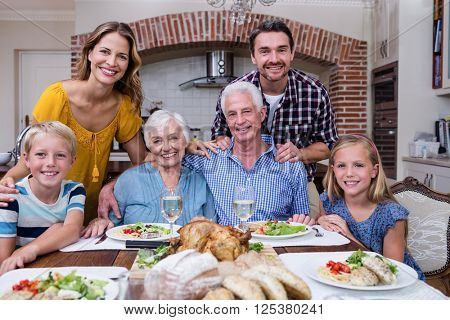 Portrait of multi-generation family having meal at home
