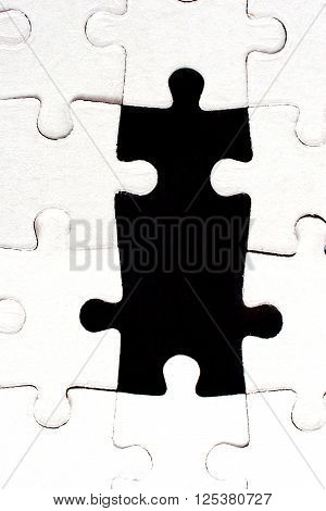 Jigsaw puzzle with two missing pieces (as a concept)