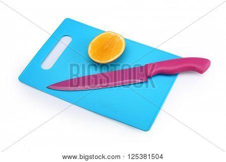 Kitchen knife on cutting board.