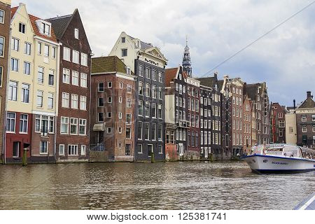 Amsterdam, Netherlands - May 4: This is bay near train station Amsterdam Central is port of pleasure boat May 4, 2013 in Amsterdam, Netherlands.
