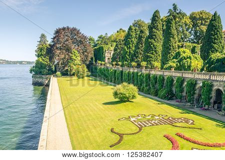 Pictured Isolabella island with its beautiful gardens and its wonderful baroque statues Lake Maggiore Stresa Italy.