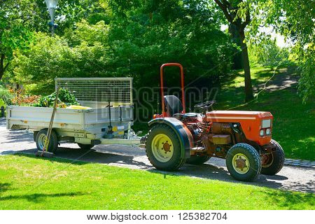 Wheeled tractor trailer in the park