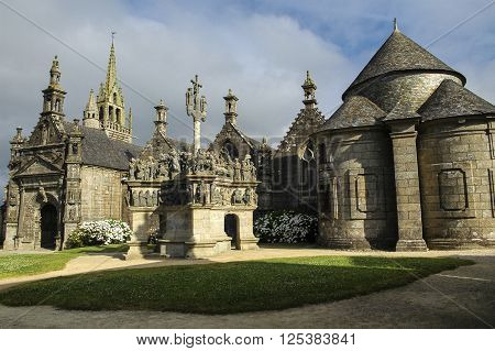 Guimiliau (Finistere Brittany France): the medieval church with the typical stone calvary