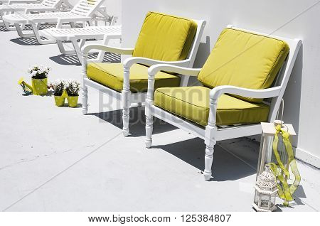 A suntrap with sofa chairs and loungers on the greek island of santorini.