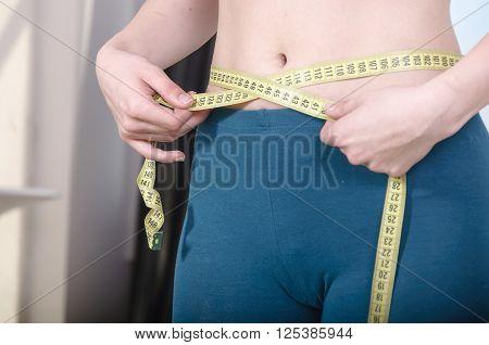 Girl Measures The Waist.