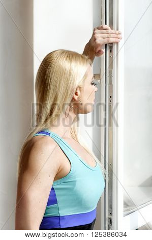 Girl With Athletic Body Opens A Window.