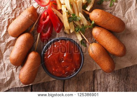 Fast Food: Corn Dogs, French Fries And Ketchup Close-up. Horizontal Top View