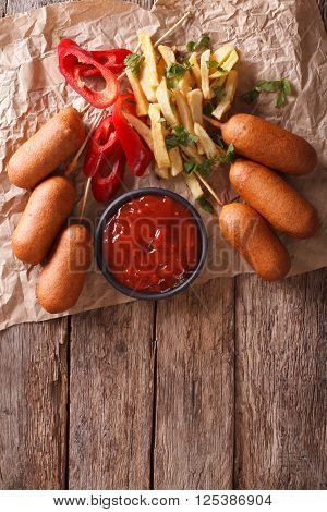 Fast Food: Corn Dogs, French Fries And Ketchup. Vertical Top View