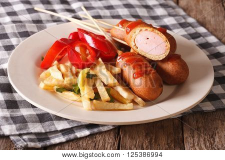 Fast Food: Corn Dog And Fries On A Plate Close-up. Horizontal
