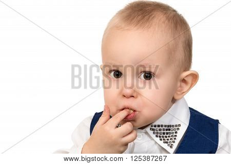 Close-up portrait of a little boy a mouth full of of crumbs and stained lips isolated on white background