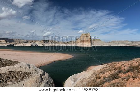 Lone Rock in Lake Powell blue sky day. Arizona USA