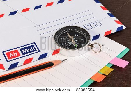 Notebook, Envelopes Airmail, Notebook, Compass And Pencil On Wood Floor.