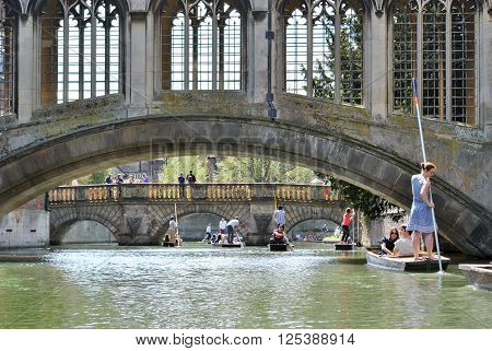 CAMBRIDGE, ENGLAND - 5 May 2013: People punting in the river Cam in Cambridge
