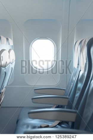 Standard, Coach Passenger Seats And Window On A Commercial Airliner Aircraft.