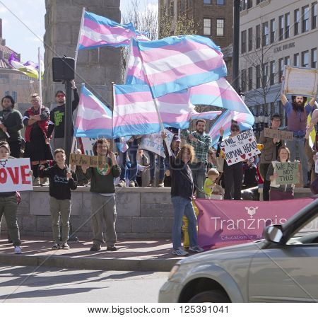 Asheville, North Carolina, USA - April 2, 2016: Colorful LGBT demonstration with protesters rallying support from passing cars in protest against North Carolina's HB2 Lawon April 2, 2016 in downtown Ashevile, NC