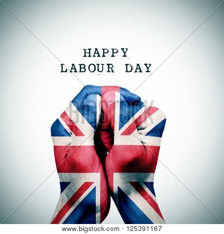 man hand patterned with the flag of the United Kingdom put together and the text happy labour day, with a slight vignette added
