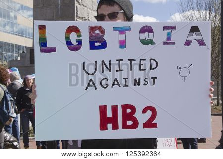 Asheville, North Carolina, USA - April 2, 2016: A man holds a HB2 legislation protest sign saying