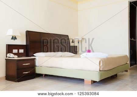 Full Size Bed In A Room At A Luxury Resort Hotel