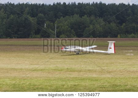 Minsk Belarus-June 21 2014: Glider on Takeoff and Landing Strip During Aviation Sport Event Dedicated to the 80th Anniversary of DOSAAF Foundation in Minsk on June 21 2014 in Minsk Republic of Belarus