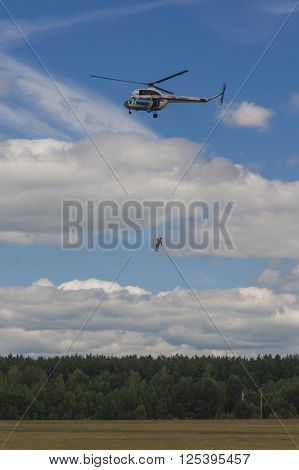 Minsk Belarus-June 21 2014: Staff of Ministry of Emergency Situations Performing Air Elements on MI-2 Helicopter During Aviation Sport Event Dedicated to the 80th Anniversary of DOSAAF Foundation in Minsk on June 21 2014 in Minsk Republic of Belarus
