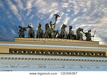 Sculptural composition named Chariot of Fame on the roof of the Headquarters in Palace Square of Saint-Petersburg Russia - closeup view in sunny weather