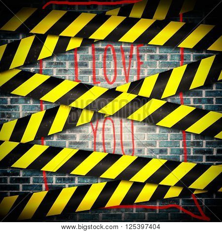 i love you against cordon tape over grey wall
