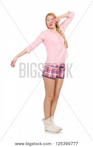 Pretty yawning girl in pink jacket isolated on white