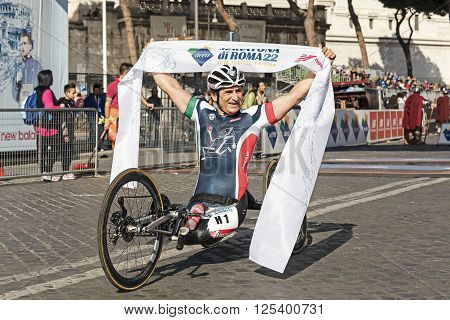 Rome Italy - April 10 2016: Alex Zanardi is the winner of the hand bike race of 22 ^ Rome Marathon. Zanardi celebrates the victory and the record time of the race.